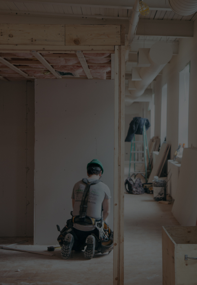 A worker working indoors in construction space